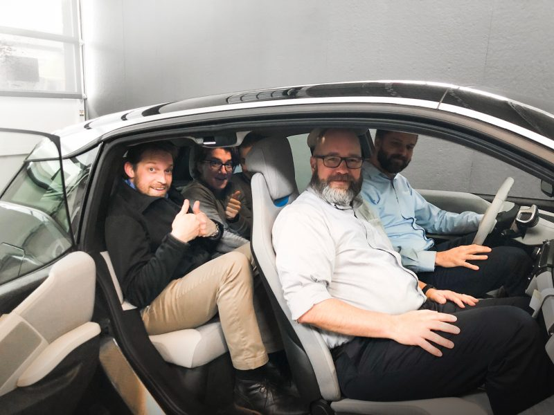 Portland Internetworks team sitting in the new BMW i3